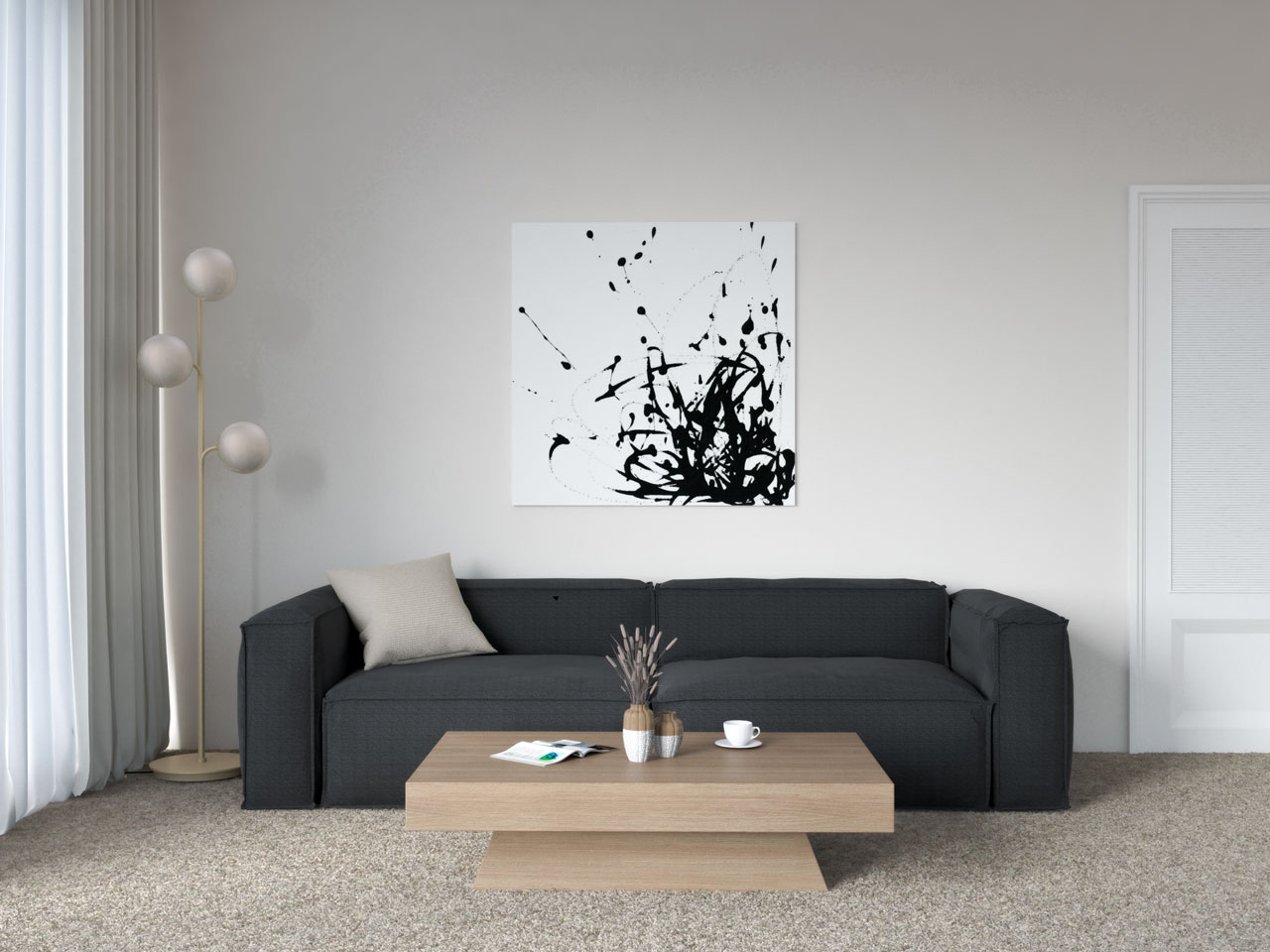 Black couch and tan carpet in living room