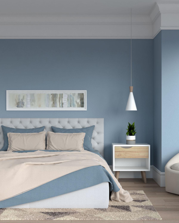 Blue and beige bedding inside blue bedroom