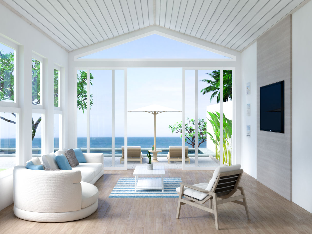 Coastal living room with brown wood flooring