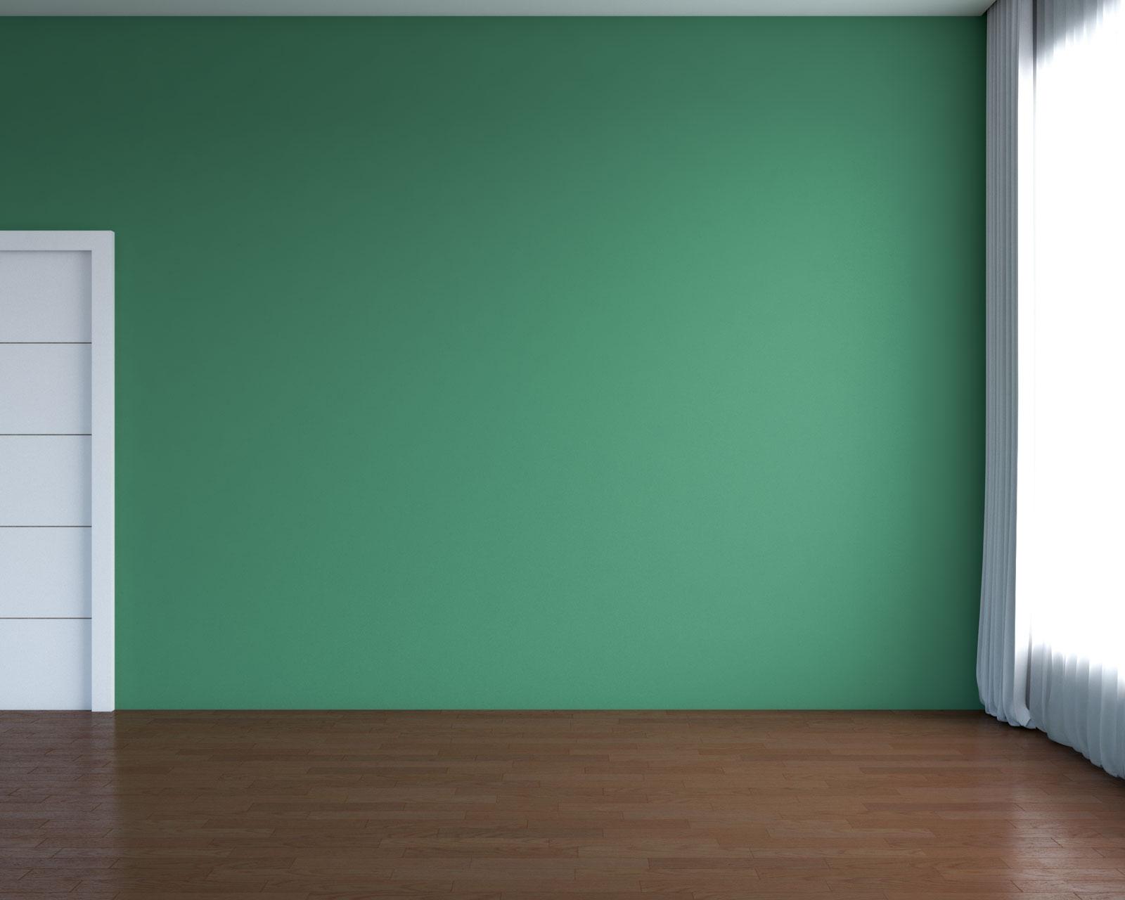 Brown hardwood flooring with green walls