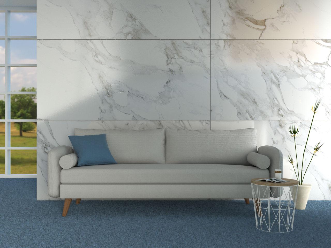 Light gray couch above blue carpet flooring