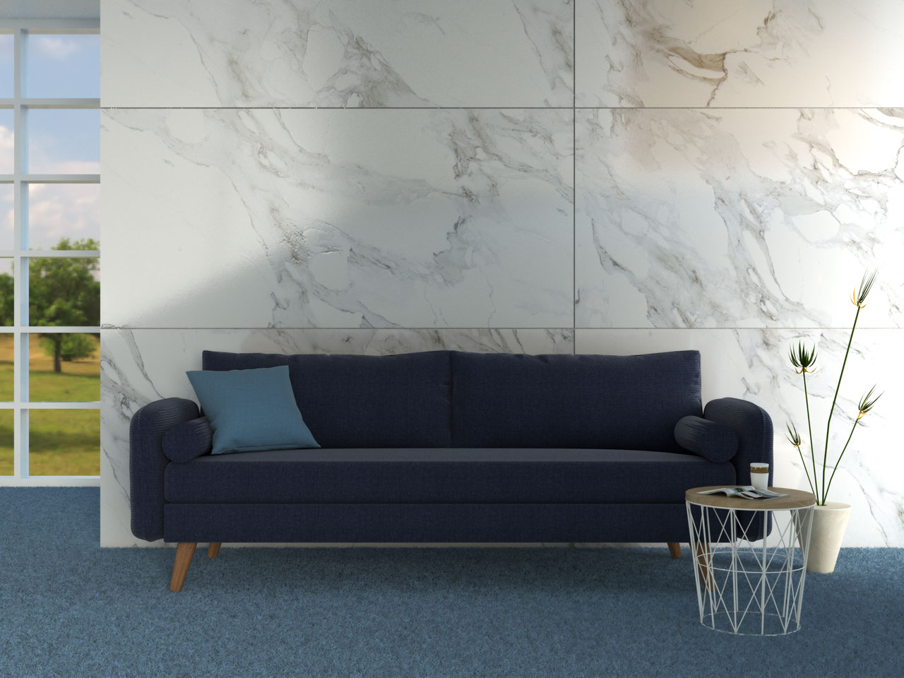 Navy couch with blue carpet flooring