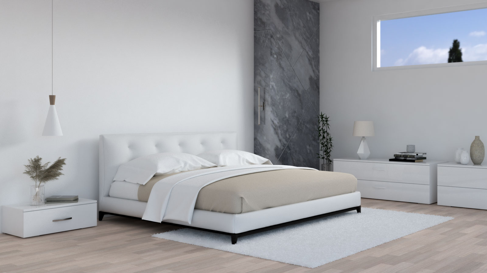 White and beige bedding in bedroom with white furniture