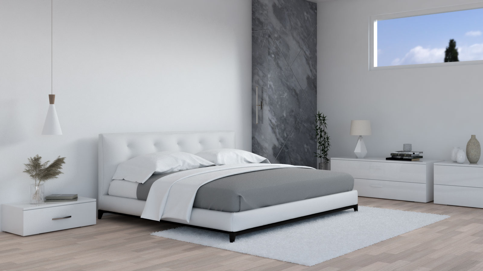White and gray bedding in white bedroom