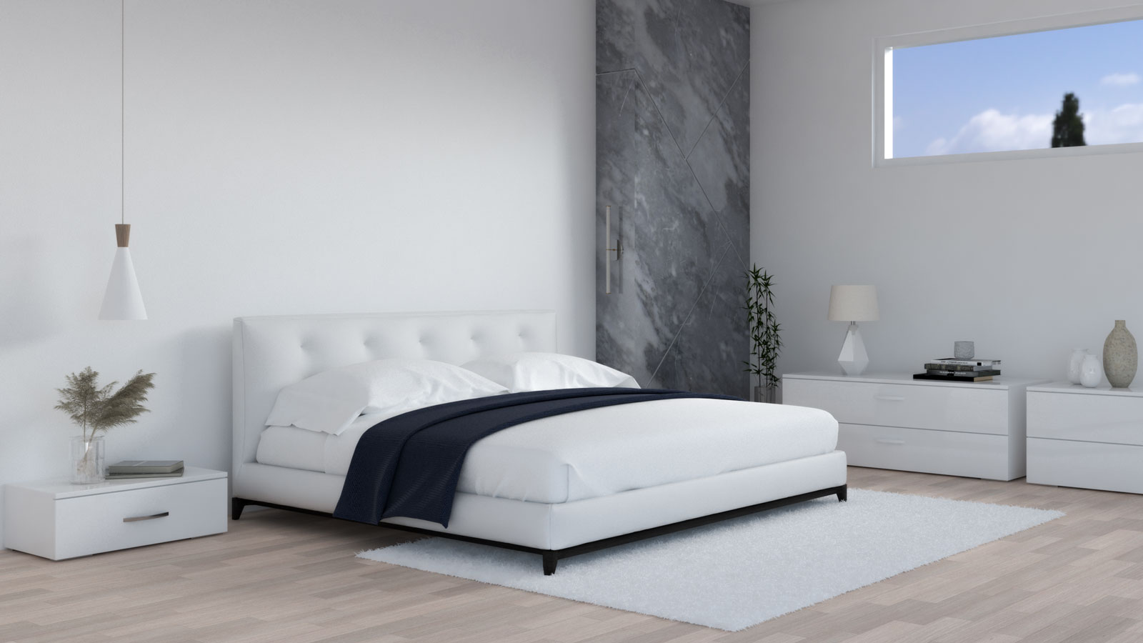 White and navy bedding with white bedroom furniture
