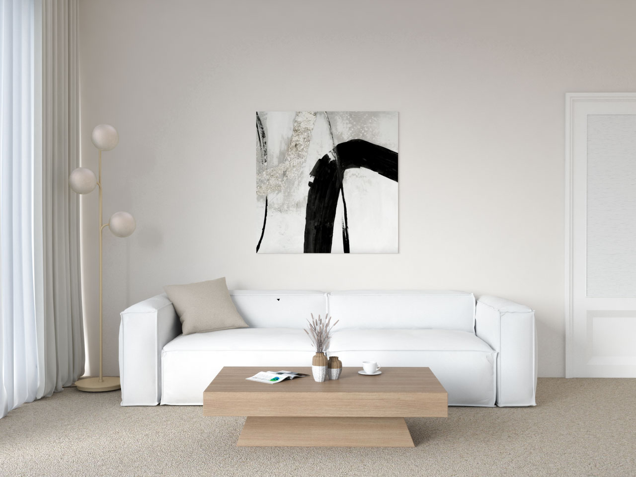 Living room with white couch and tan carpet flooring