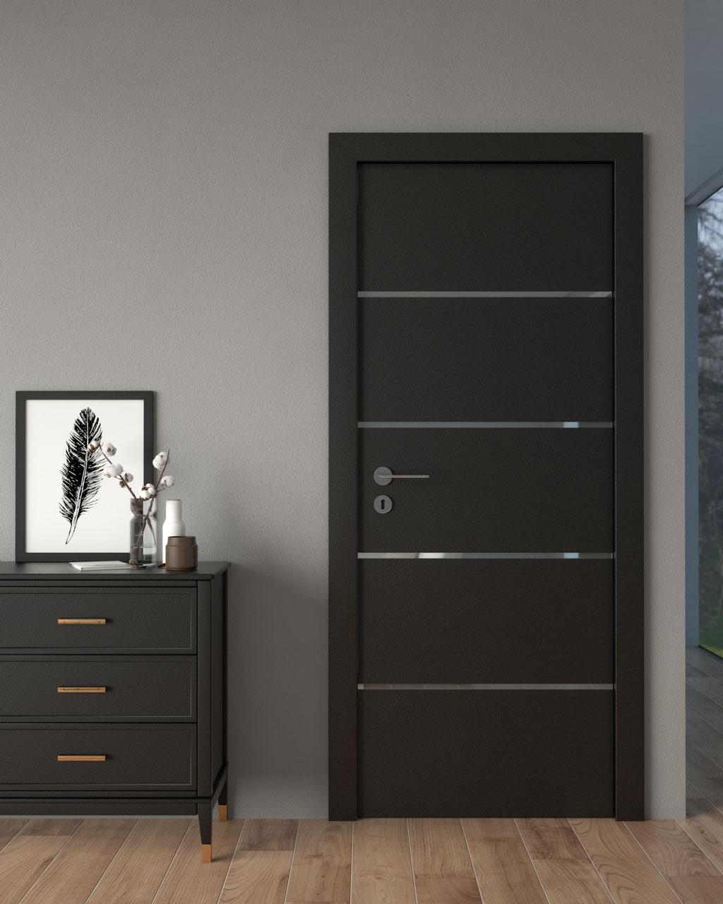 Black door with gray walls
