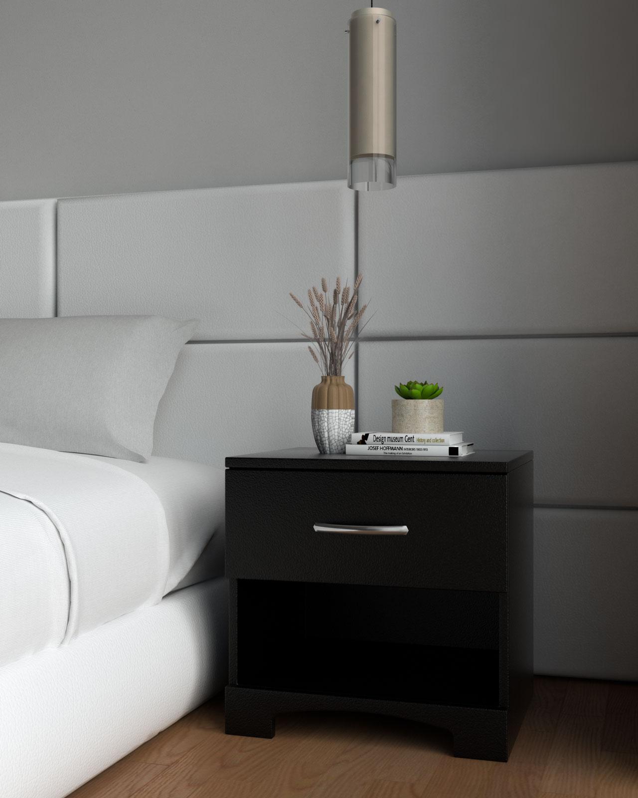 Black nightstand beside white bed