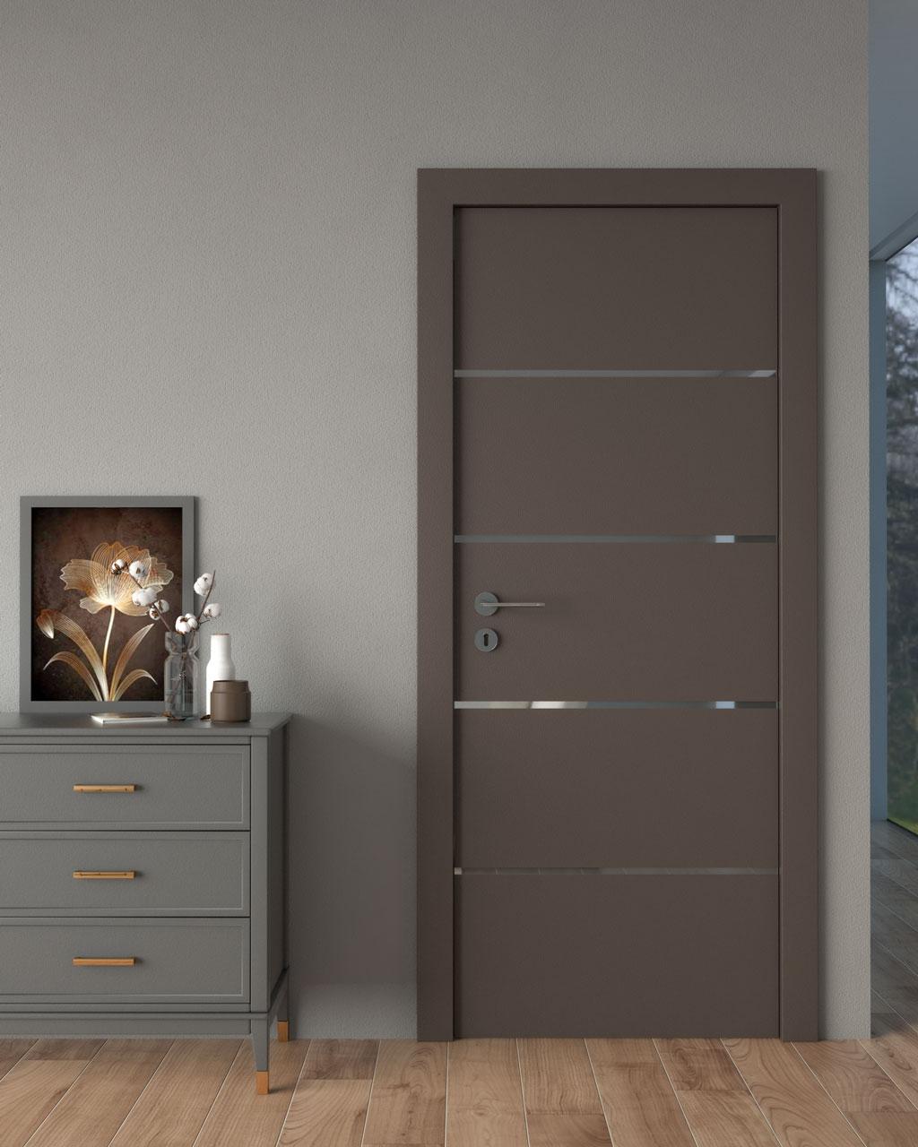 Dark brown door with gray walls