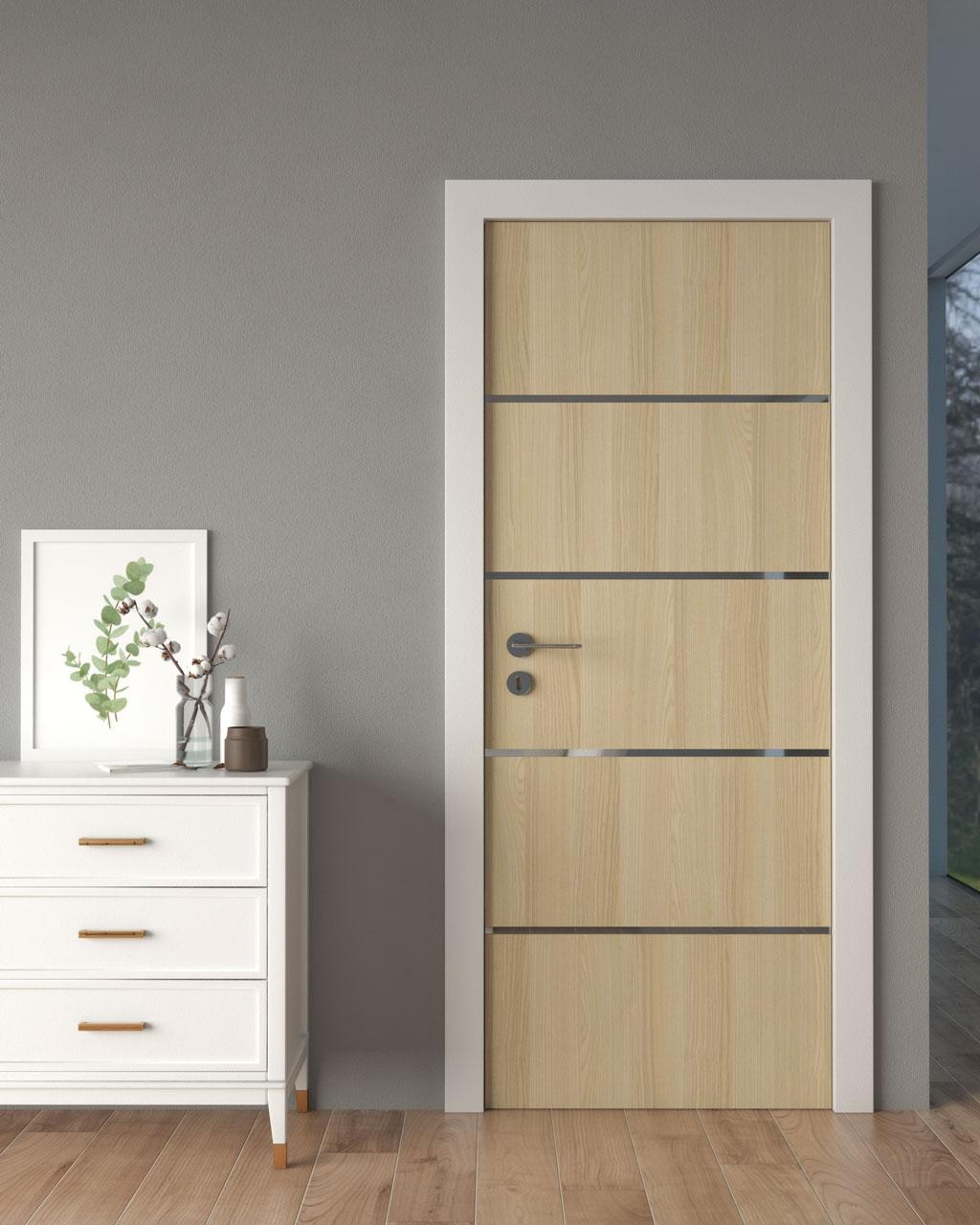 Light cream wooden door with grey walls