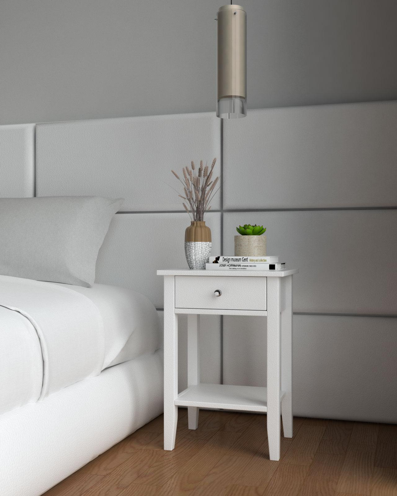 White nightstand alongside white bed