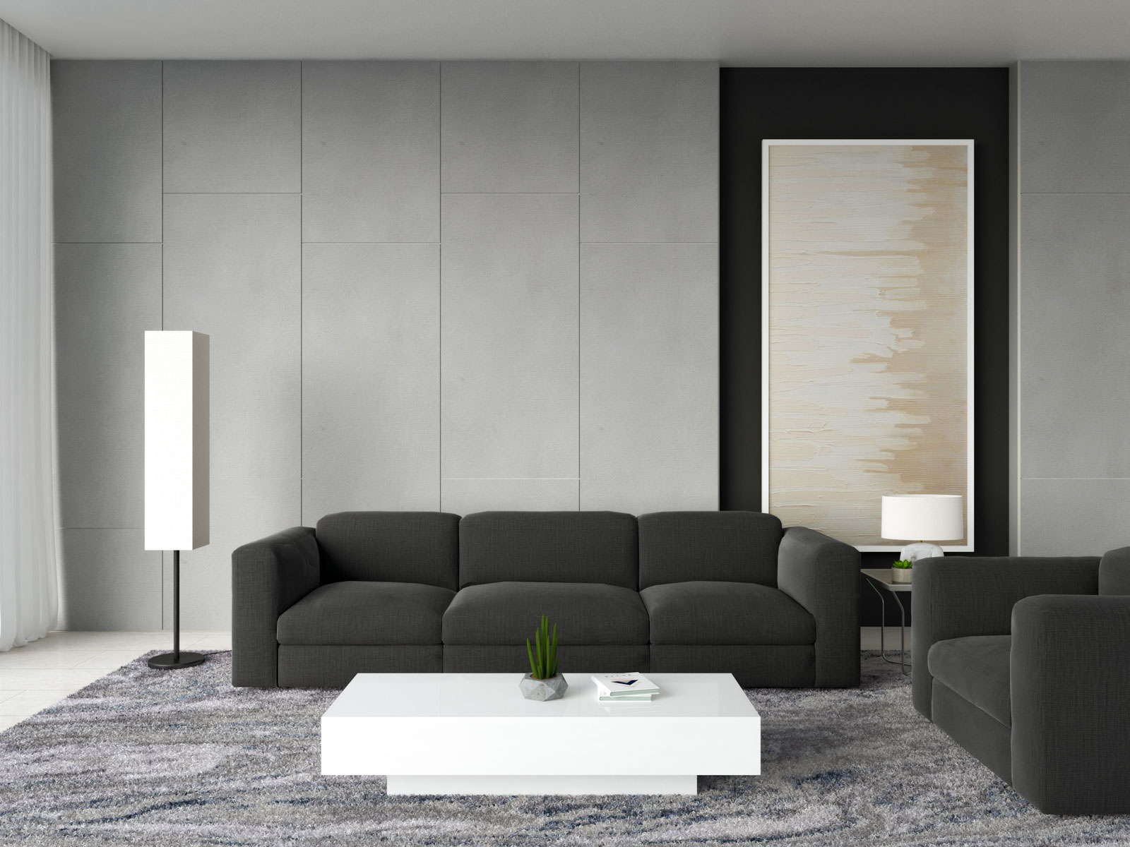 White coffee table with black couch