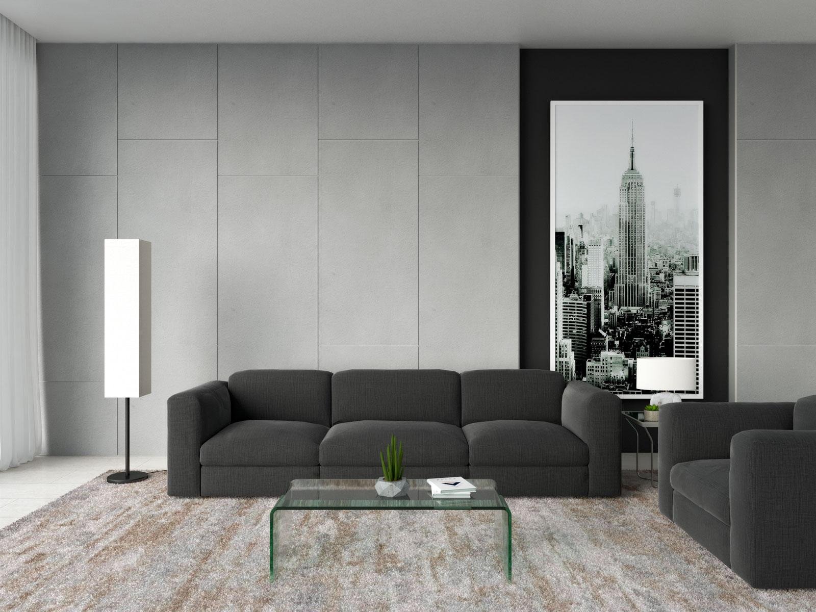 Glass coffee table with black sofa
